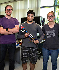Michael Moores, senior electrical engineering major; David Garcia, senior mechanical engineering major; and Lauren Pernu, senior mechanical engineering major, made a breakthrough this year on their 3-D printable prosthetic hand prototype project by controlling the arm with a Myo gesture armband.