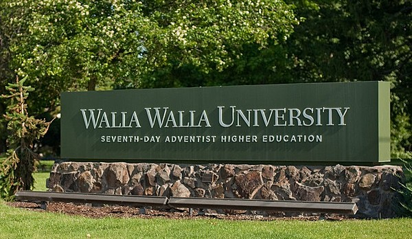 Walla Walla University sign in the middle of campus.