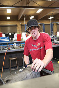 Student working in the auto shop
