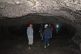 Students explore Mile Long Cave. The ceiling eventually got so low that they needed to army crawl forward.