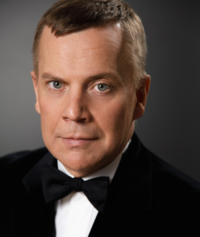 Formal portrait of Paul Richard Olson in black tuxedo.