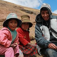 Civil engineering student Josue Hernandez enjoys time with children in Peru during the 2015 EWB-WWU project.