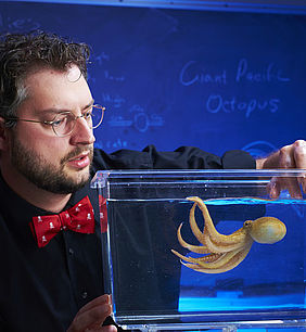 Kirt Onthank, assistant professor of biology, with one of the octopuses he studies.