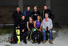 A group of students dressed in their scuba gear pose for the camera with Alex Bauer, the film and video director for the Octopodium.