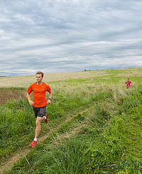 In the sport of cross-country, teams of men and women run outdoors through open country.