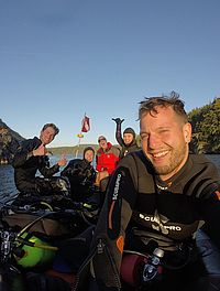 WWU scientific divers take a break from exploring to take a selfie at Rosario.