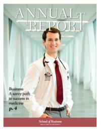Male medical student in a white coat stands smiling on the cover of the 2017 Annual Report.