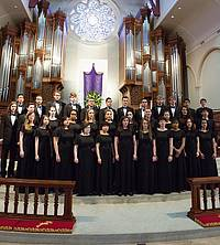 The 2017 I Cantori choir dressed in their black dresses and tuxes.