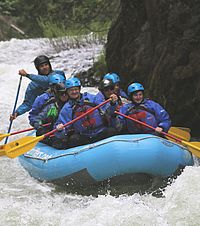 April Riseley (seated front right) enjoyed her trip down the White Salmon River, especially relishing the many waves that washed over the raft.