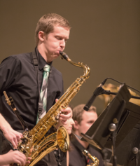 WWU student plays a saxophone solo in the wind ensemble.