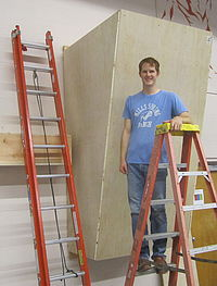 Humphries poses during construction of the campus board.