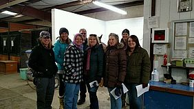 Perry (third from left) and her staff gather at Horses Spirits Healing, Inc., a nonprofit organization the Billings clinic occasionally collaborates with that specializes in equine-facilitated psychotherapy.