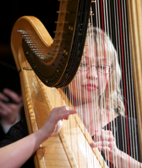A WWU student plays the harp in concert.