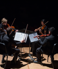 The WWU string quartet performs onstage in the annual PRISM concert.