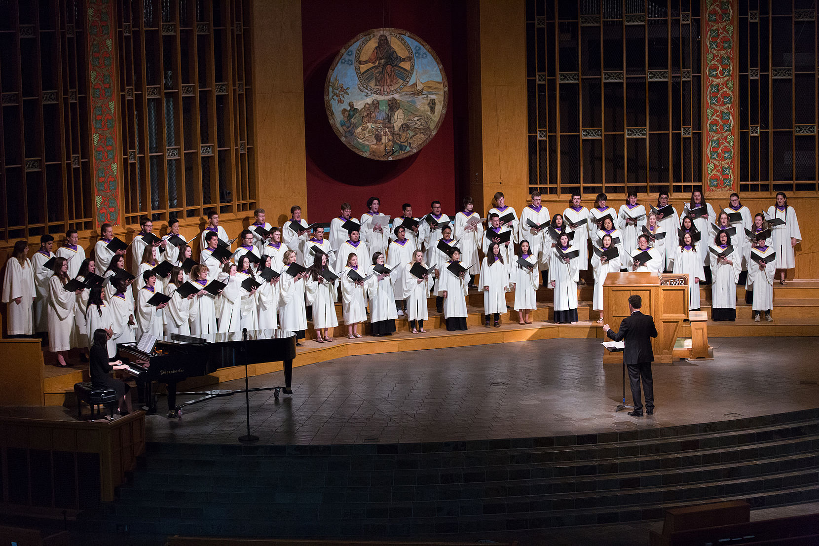 The Walla Walla University University Singers choir singing on stage at the University Church