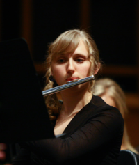 WWU student plays the flute in a wind symphony concert.