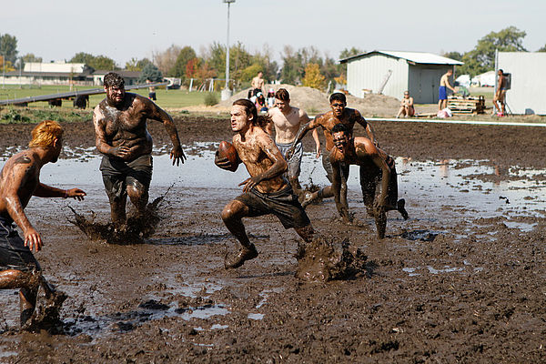 Students compete against one another during the annual OPS mud football competition.