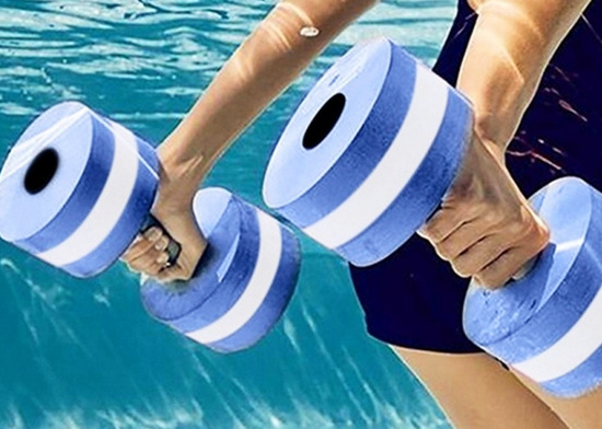 Water aerobics student uses water weights in the pool.